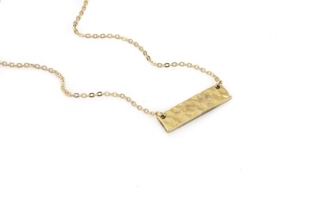 Made from a 50-caliber shell casing, this unique piece of jewelry is truly one of a kind.