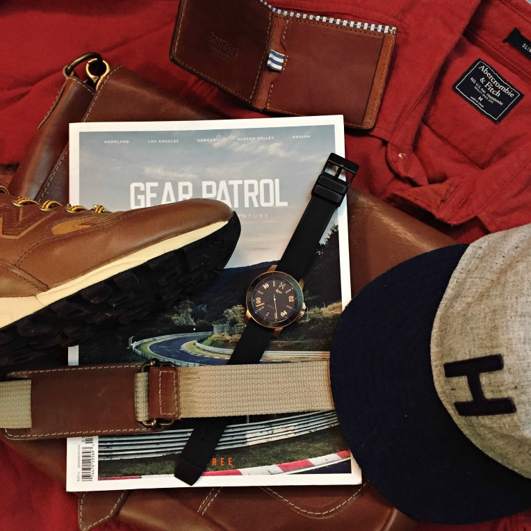 Travel essentials fit for hitting the road and fighting the cold. Chamois Shirt by Abercrombie & Fitch. Explorer's Cap by Huckberry. Messenger bag and 810 Wallet by Brothers Leather. Calypso Watch by MVMT Watches. miUSA 585 Sneakers by New Balance. Magazine by Gear Patrol.